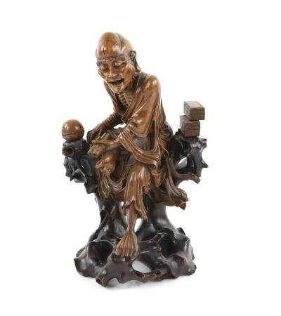 Chinese carved hardwood figure of a seated old man holding a scroll, on integral base, 30.5cm high,