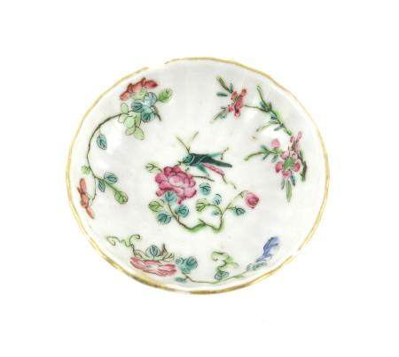 Chinese famille rose dish, decorated with a feeding grasshopper flowers and foliage, 8cm diameter,