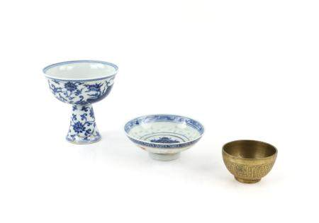 A blue and white stem cup with six-character nien-hao of The Xuande Emperor, but not of the period,