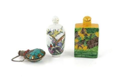 Three Chinese snuff bottles, comprising one famille rose decorated with an exotic bird amongst