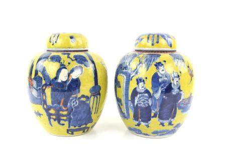 Pair of Chinese yellow ground jars and covers with figures in underglaze blue, four-character mark