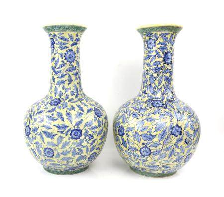 Pair of 20th century Chinese blue and yellow floral decorated vases, 43cm high, another pair