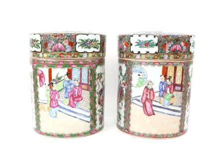 Pair of 20th century famille rose cylindrical jars and covers, decorated with panels of figures,