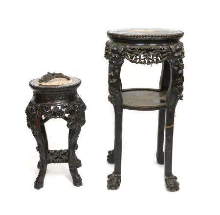 Two late 19th/early 20th century marble topped carved hardwood plant stands with foliate decoration,