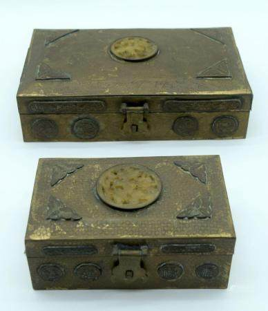 Two small bronze panelled Chinese boxes heavily embossed and circular Jadeite inserts 23 x 15cm (2)