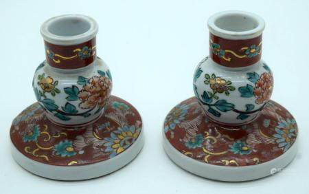 A pair of 19th Century Japanese Kutani ceramic candlestick holders 10cm (2)