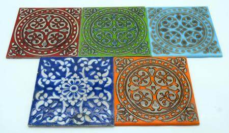 A collection of vintage ceramic tiles in an Islamic style 15 x 15cm (5).