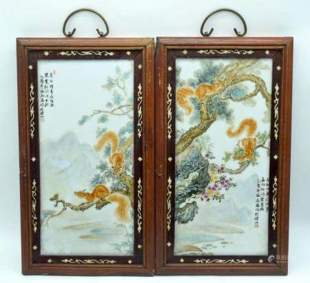 A pair of framed Chinese Porcelain panels decorated with Squirrels in a landscape 37 x 17cm (2)