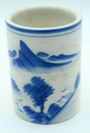 A Chinese blue and white brush pot decorated with a mountainous Landscape 14cm.