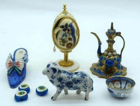 A Miscellaneous group including a Delft dog, enamelled Ewer, glass pendants etc (9).