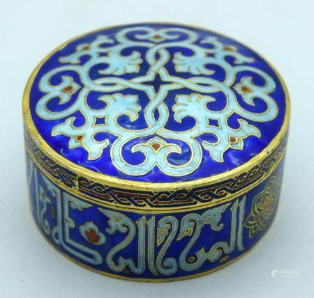 A small enamelled Islamic lidded box 8 x 4cm