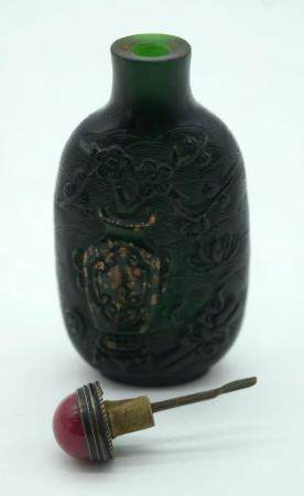 A Chinese carved Snuff bottle decorated with a gilded vase and foliage 8.5cm.