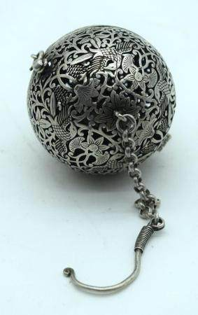 A Chinese white metal open work incense burner 6cm.
