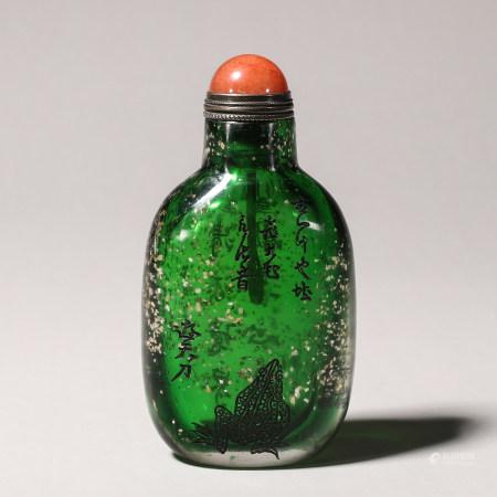 A gold sprinkled inscribed glass snuff bottle
