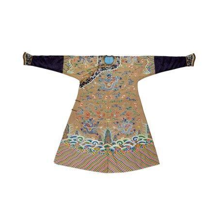 A brown-ground 'dragon' kesi robe, jifu Qing dynasty, 18th century | 清十八世紀 駝色緙絲八吉祥雲蝠九龍吉服袍