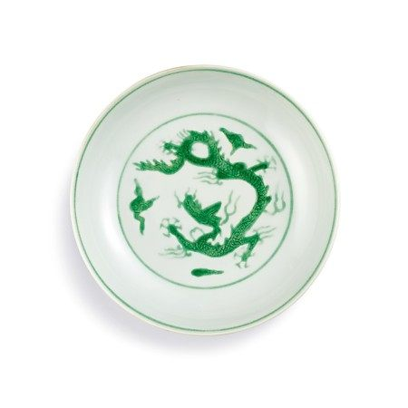 A fine and rare incised green-enamelled 'dragon' dish Mark and period of Zhengde | 明正德 白地暗刻海水素胎綠彩雲龍紋盤 《大明正德年製》款