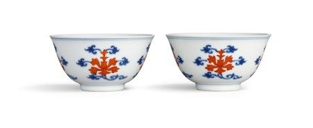 A fine pair of underglaze-blue and iron-red 'lotus' cups Seal marks and period of Qianlong | 清乾隆 青花礬紅折枝番蓮紋盃一對 《大清乾隆年製》款