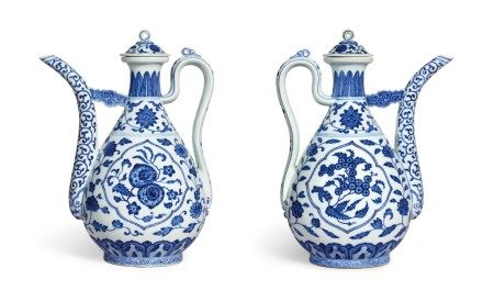 A rare pair of Ming-style blue and white ewers and covers Seal marks and period of Qianlong | 清乾隆 青花開光花果紋執壺一對 《大清乾隆年製》款