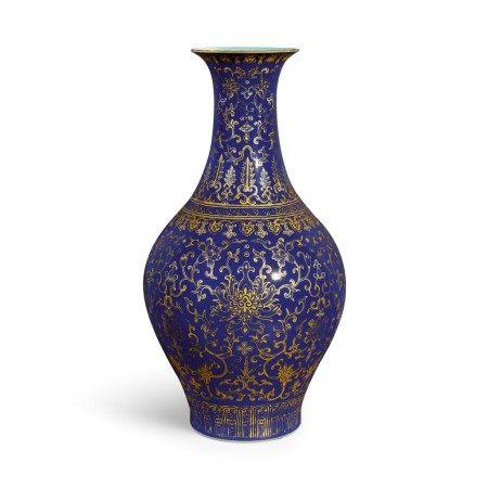 A rare blue-ground gilt-decorated 'lotus' vase, ganlanping Seal mark and period of Jiaqing | 清嘉慶 藍地描金蓮紋橄欖瓶 《大清嘉慶年製》款