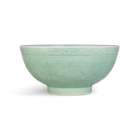 A moulded and incised celadon-glazed 'herbaceous peony' bowl Seal mark and period of Qianlong | 清乾隆 粉青釉纏枝芍藥大盌 《大清乾隆年製》款