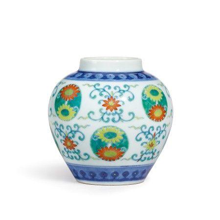 A doucai 'lotus and chrysanthemum' jar Seal mark and period of Qianlong | 清乾隆 鬪彩番蓮團菊紋罐 《大清乾隆年製》款