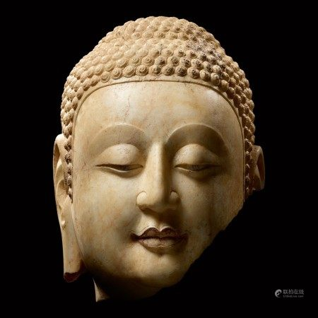 A superbly carved rare marble fragmentary head of Shakyamuni Buddha Northern Qi dynasty | 北齊 大理石釋迦牟尼佛首