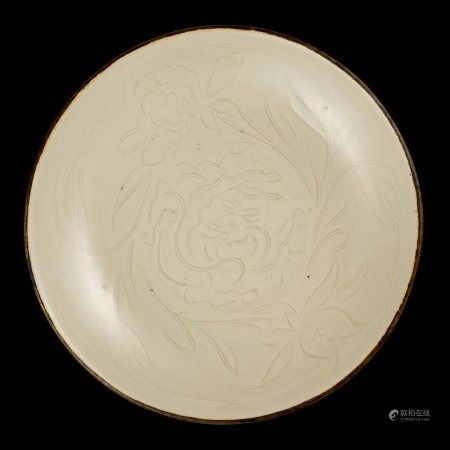 A rare carved Dingyao 'chilong' dish Song dynasty | 宋 定窰白釉刻螭龍牡丹紋盤
