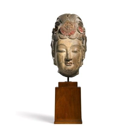 An extremely rare large limestone head of a bodhisattva Sui dynasty | 隋 石灰岩加彩菩薩頭像