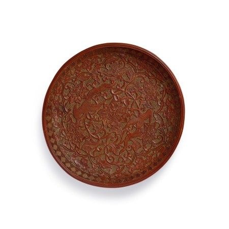 A rare carved cinnabar lacquer 'phoenix' dish Song dynasty | 宋 剔紅鳳穿牡丹紋盤