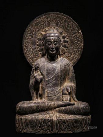 A STONE SITTING BUDDHA STATUE