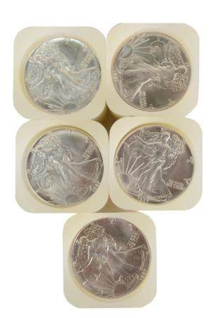 Five Rolls of Liberty Silver Dollars, one hundred 1987 coins total.