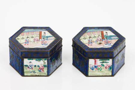 A pair of boxes with covers