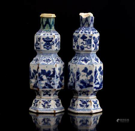 2 Chinese porcelain octagonal vases decorated with landscapes, symbolic objects and flowers, Kangxi