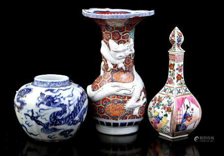 Lot of Chinese porcelain b.u. vase with dragon decoration in relief, pot with dragon decoration and