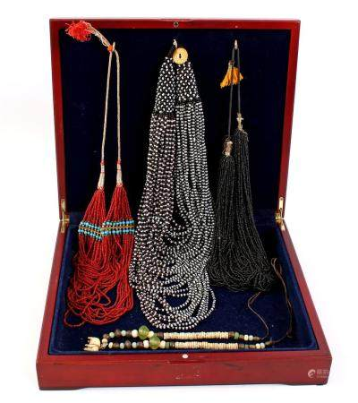 Wooden box with Asian jewelry