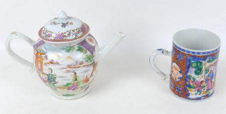 A Chinese porcelain famille rose teapot, with strapwork handle, decorated with two reserve panels