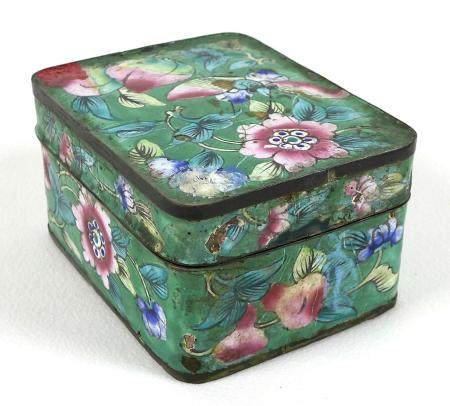 A Chinese enamel box and cover, of rectangular section with rounded corners, decorated with sprays