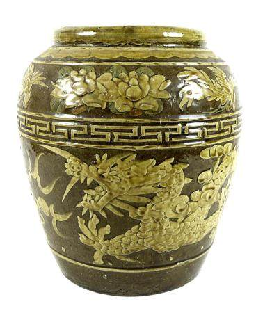 A large Chinese stoneware vase, with relief moulded decoration to the body depicting a dragon