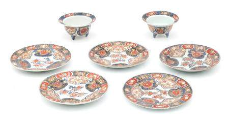 Two Japanese Imari bowls and five plates, 19th century.