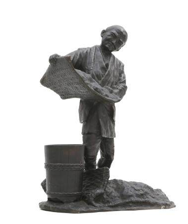 A Japanese bronze sculpture of a man with bucket and sieve, signed, Meiji-period.