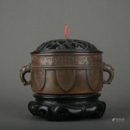 A bronze incenser burner
