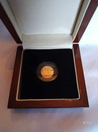 A 24CT GOLD TRAFALGAR 1/3 GUINEA PROOF COIN, 2008, TRISTAN DA CUNHA In a protective capsule and fitted wooden box, complete with certificate of authenticity. (approx total weight 2.8g)