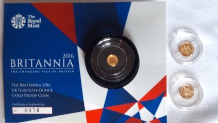TWO 18CT GOLD COMMEMORATIVE PROOF COINS The Queens Diamond Jubilee 1953 portrait, 50 Franncs CFA, together with a 2016 24ct gold Britannia fortieth ounce coin, in protective capsules, complete with certificate of authenticity.  (approx total weight 1.8g)  Condition: good