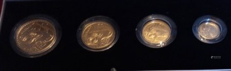 A 22CT GOLD BRITANNIA FOUR COIN PROOF SET, DATED 2003 Comprising a one hundred pound coin, fifty pound coin, twenty-five pound coin and ten pound coin, in protective capsules and fitted red leather box, complete with certificate of authenticity.  (approx total weight 63g)  Condition: good overall, outer cardboard cover with slight wear