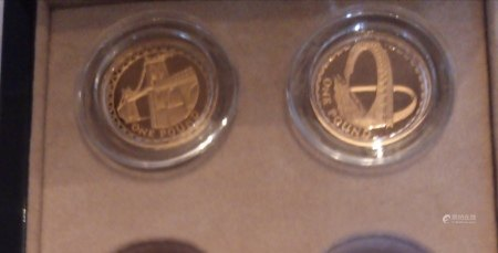 TWO 22CT GOLD ONE POUND PROOF COINS, DATED 2005 AND 2007, MENAI STRAITS SUSPENSIONS BRIDGE AND GATESHEAD MILLENNIUM BRIDGE In a protective capsule and fitted wooden box, complete with certificate of authenticity. (approx total weight 38g)  Condition: good overall, slight wear to outer cardboard box
