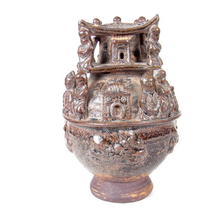 A Chinese treacle glazed funerary soul urn.
