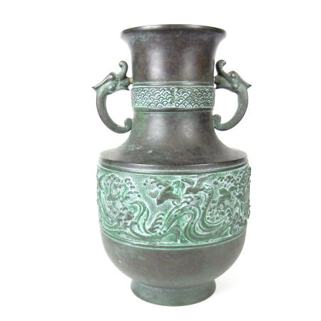 A Chinese twin handled bronze vase