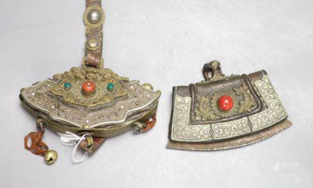 Two Tibetan Chukmuk or tinder pouches, in leather, brass and white metal, with belt straps, one