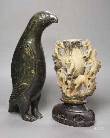 A 19th century Chinese soapstone vase, carved with monkeys, together with an inuit stone carving