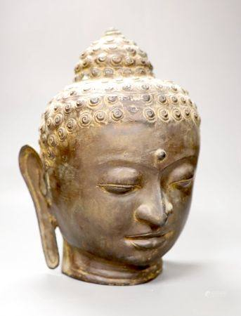 A Sino Tibetan bronze buddha head, height 33cm